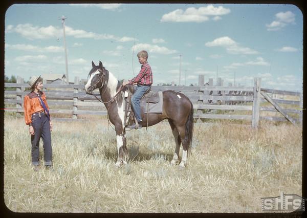 Burton Ismond on horse back.  Shaunavon.  07/25/1950