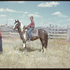 Burton Ismond on horse back.  Shaunavon.  07/25/1950