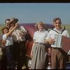 Accordianist & girl at International picnic; John Andrejein & Susan Loewen - Brooks Alberta.  Divide.  07/12/1953