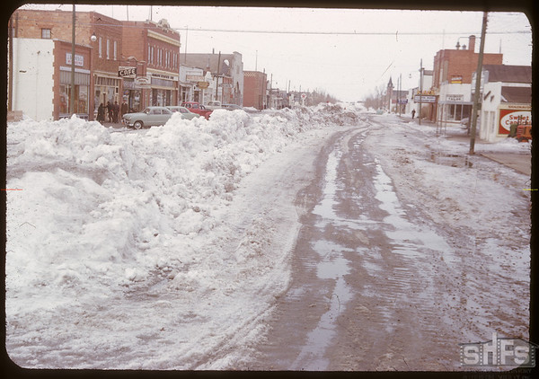 Snow covered Centre Street looking north.  Shaunavon.  03/25/1951