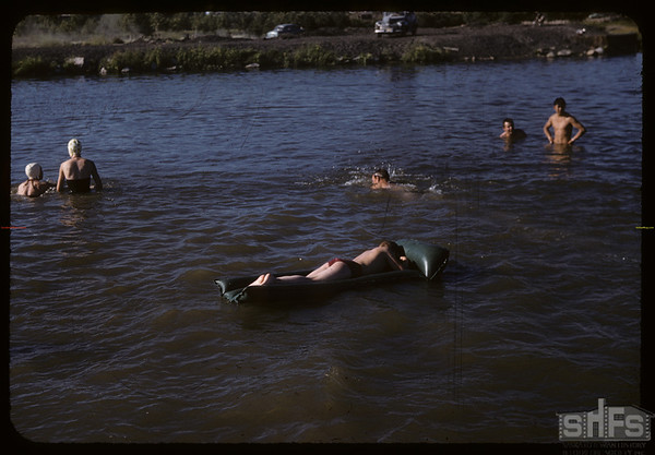 riding an air mattress at the Swift Current Dam.  Swift Current.  07/11/1957