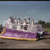 Jubilee Fair Parade - Royal Purple float.  Shaunavon.  07/26/1955