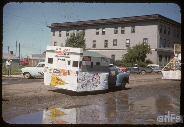 Jubilee Fair Parade - Co-op Lumber yard float.  Shaunavon.  07/26/1955