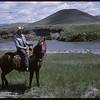 Les Gadland on horse back.  Shaunavon.  06/07/1966