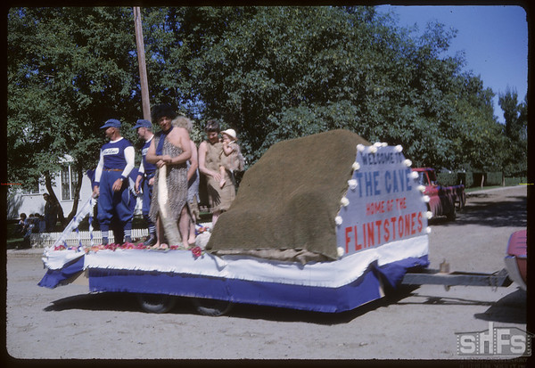 Rodeo Parade - Float depiciting 'Cave Home of the Flintstones'.  Shaunavon.  07/20/1964