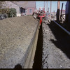 Digging of gas line - alley between Centre and 1st St. E. between 3rd & 4th Ave N..  Shaunavon.  09/10/1962