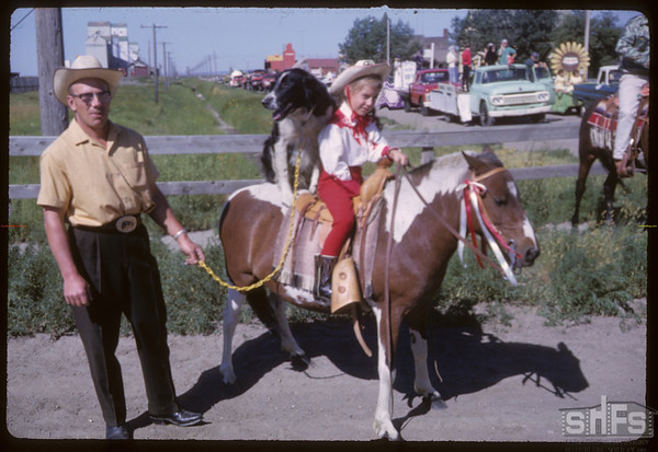 Rodeo Parade - Mel Lidfors with daughter on pony.  Shaunavon.  07/20/1964
