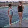 Shaunavon's new swimming pool - Diane Halderman pool life guard and Marcia Hansen.  Shaunavon.  09/02/1965