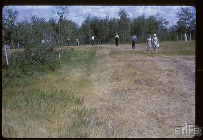 Bus tour visiting Middleton's trenches. Batoche. 07/04/1964