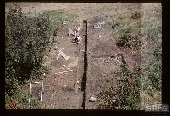 Gull Lake archaeologist's dig - Tom & Alice Kehoe - looking east. Gull Lake. 07/16/1960