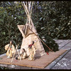 Mrs. Jim Ogle's sculpture of teepee and occupants.  Wood Mountain.  09/05/1965