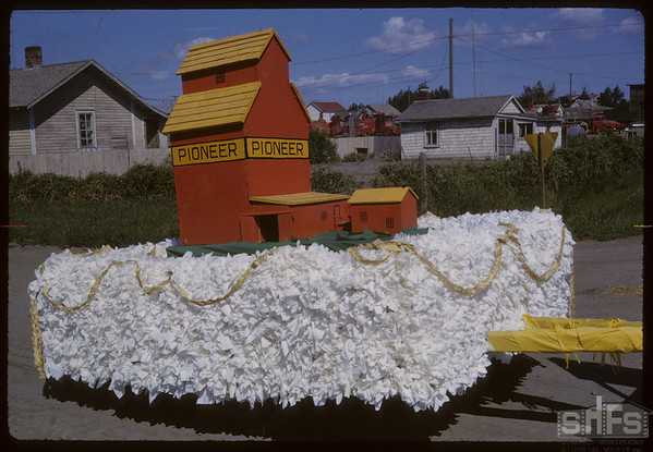 Shaunavon Jubilee Parade - Pioneer Elevator float.  Shaunavon.  07/17/1963