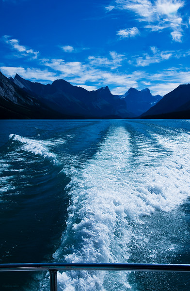 """October 6, 2013<br /> <br /> Cruisin' Maligne Lake<br /> <br /> * I recently took the Maligne Lake cruise, while in Jasper, and shot this image from the back of the boat. It was a great day!!!<br /> <br /> I recently entered this image into a  photo contest where the assignment was to """"freeze water"""" with a fast shutter speed, such as 1/500 sec or more. What I realized is that I hardly ever do this!! More often than not, I am trying to get a long exposure where I create silky water, as opposed to the sharp, crisp water you get from a fast shutter speed.  Something to keep in mind next time :)"""