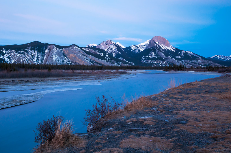 January 17, 2015<br /> <br /> Mountain Morning <br /> <br /> Athabasca River<br /> Jasper National Park, Alberta<br /> <br /> The east side of Jasper is very windy. As you can see from the foreground, it does not look like January in the Rocky Mountains but it is!! When shooting here you need to hang onto your tripod and bundle up :))<br /> <br /> * For the month of January I will, once again, be posting images from my annual trips to Jasper in January.