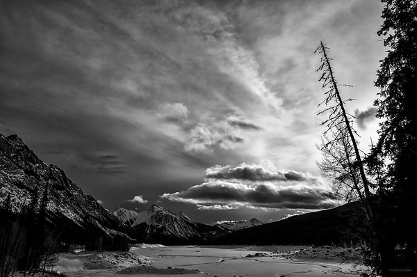 February 19, 2015  Medicine Lake Jasper National Park, Alberta  * This mid-day scene was quite monochromatic to begin with. When I looked at it as a black and white image, I really enjoyed the contrast of the dark and light sky. I took it into Silver Efex to create this B&W.