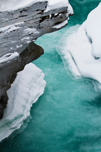 January 19, 2013<br /> <br /> Glacial Waters<br /> <br />  * This is an image taken looking down into the canyon the Athabasca River flows into after it cascades down the falls. The colour of the water and the glacial ice is amazing. <br /> <br /> Athabasca Falls<br /> Jasper National Park, Alberta<br />  <br /> Jasper in January - Embrace winter!