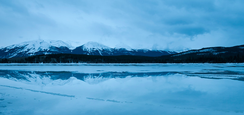 January 26, 2015<br /> <br /> Morning Reflection<br /> <br /> Pyramid Lake<br /> Jasper National Park, Alberta<br /> <br /> J in J 2015 - This is the first time I have seen the lake with a layer of water on it, at this time of year. It was plus 8 and overcast so we did not get any sunrise colours but these great reflections were a treat!!<br /> <br /> * For the month of January I will, once again, be posting images from my annual trips to Jasper in January.