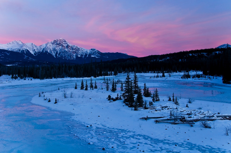January 4, 2014<br /> <br /> Winter Sunrise<br /> <br /> This image looks in the other direction to the one I posted yesterday. Photographer's heaven!! Sometimes I just keep turning in circles on this bridge :)<br /> <br /> Athabasca River<br /> Jasper National Park, Alberta<br /> <br /> * Jasper in January<br /> For the month of January, I will be editing images from my annual trips to Jasper in January.