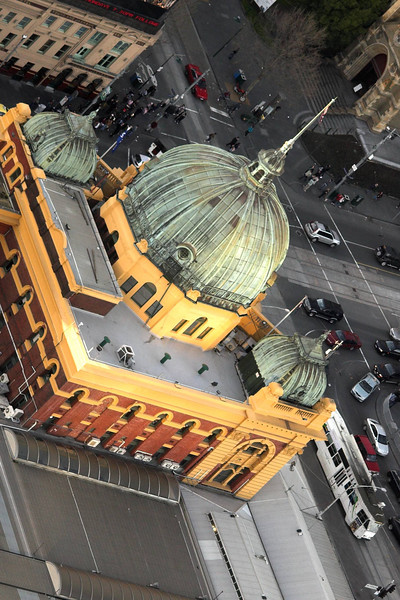 Flinders Street Station Dome. The Eureka Tower now looms behind a number of locations in Melbourne. The classic photograph of the Station with its Clocks, taken from in front of St Paul's Cathedral is liable to have the Eureka Tower intruding, unless you stand slightly to the side.
