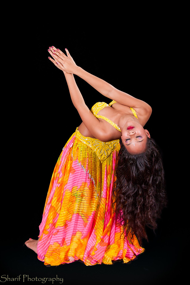 Young belly dancer in backbend to right