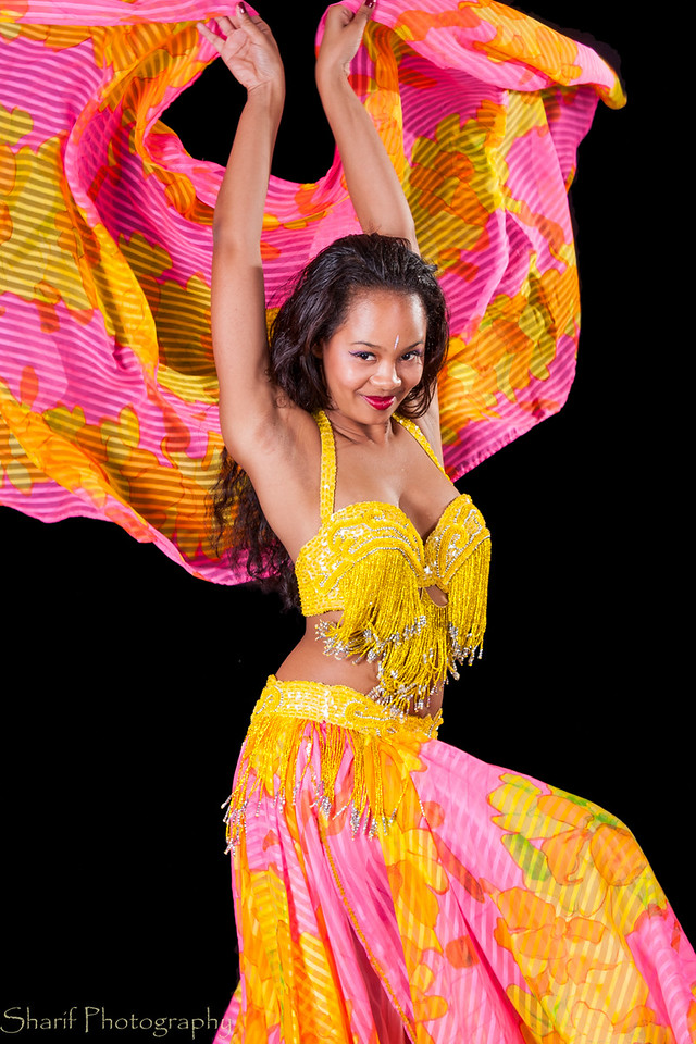Young belly dancer dancing with veils