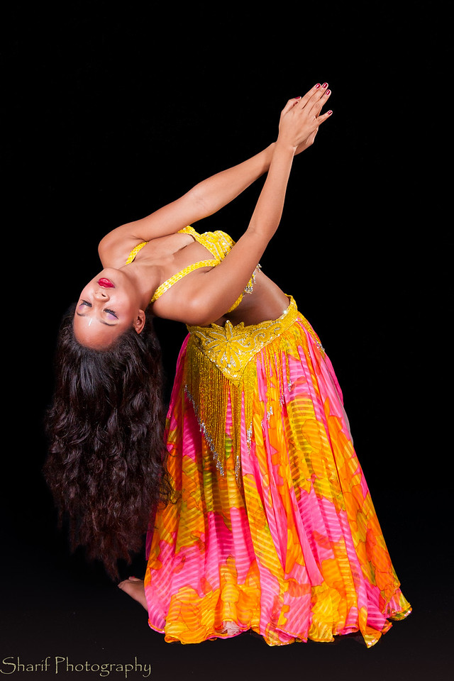 Young belly dancer in backbend to left