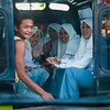 "Friendly girls in their traditional Muslim attire, traveling in the local ""Bemo"" taxis. Image taken from the front seat of our car. Everywhere we went, there were smiles all around...but maybe it's cuz i look so darn funny."