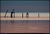 """12Mar08  old pier sunrise, waveland, ms.  <a href=""""http://carpelumen.smugmug.com/gallery/2530267_2Xcsn/1/135573235_FQM6x/Medium"""">one year ago.</a>  f/6.3, 1/200s, iso 640."""