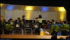 """20Mar08  leading the tuning.  the local middle school's 7-8th grade orchestra performed at the countywide middle school board scholar program.  they recently scored straight 1's at state festival.  <a href=""""http://carpelumen.smugmug.com/gallery/2530267_2Xcsn/1/137515628_iqsoe/Medium"""">one year ago.</a>  f/6.3, 1/50s, iso 640."""
