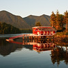 August 21, 2009<br /> The Red House at Sunset.<br /> <br /> In Tofino we stayed in small cottage overlooking Tifino harbor. From our porch we enjoyed beautiful views of Tofino bay and surroundings. This red house looked magnificent at sunset.