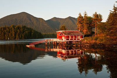August 21, 2009 The Red House at Sunset.  In Tofino we stayed in small cottage overlooking Tifino harbor. From our porch we enjoyed beautiful views of Tofino bay and surroundings. This red house looked magnificent at sunset.
