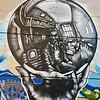"August 7, 2009<br /> This graffiti is great reproduction of ""Hand with Reflecting Sphere"" by M.C. Escher. I found it in downtown of Vancouver in dark alley a block from Hastings Street. Graffiti is done by ""Cold World Media"" artist.<br /> What is really interesting - Vancouver has a mural program that provides legitimate way for graffiti writers and other artists to display their work."