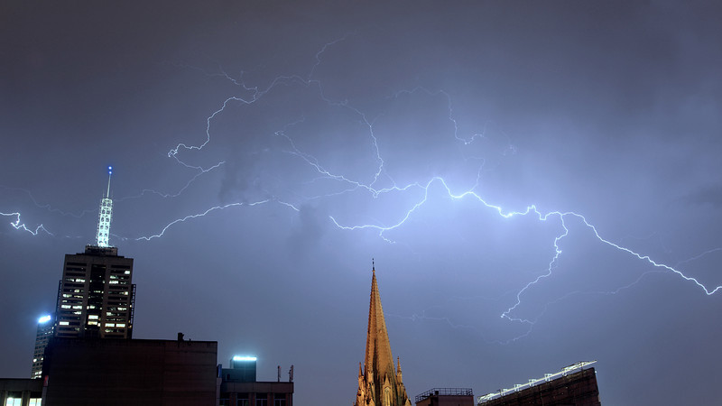 A photo of lightning seen in Melbourne on 31st October 2009. (The night before there had been a few feeble flashes of lightning and I commented to some friends that these days we weren't seeing the spectacular thunderstorms that happened soon after we moved to the apartment. And then tonight we had lightning that was about as good as any I've ever seen.
