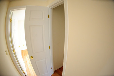small coat closet near den