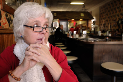 Lyn, pensive in a Wisconsin cafe.