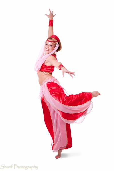 Retro belly dancer making an arabesque