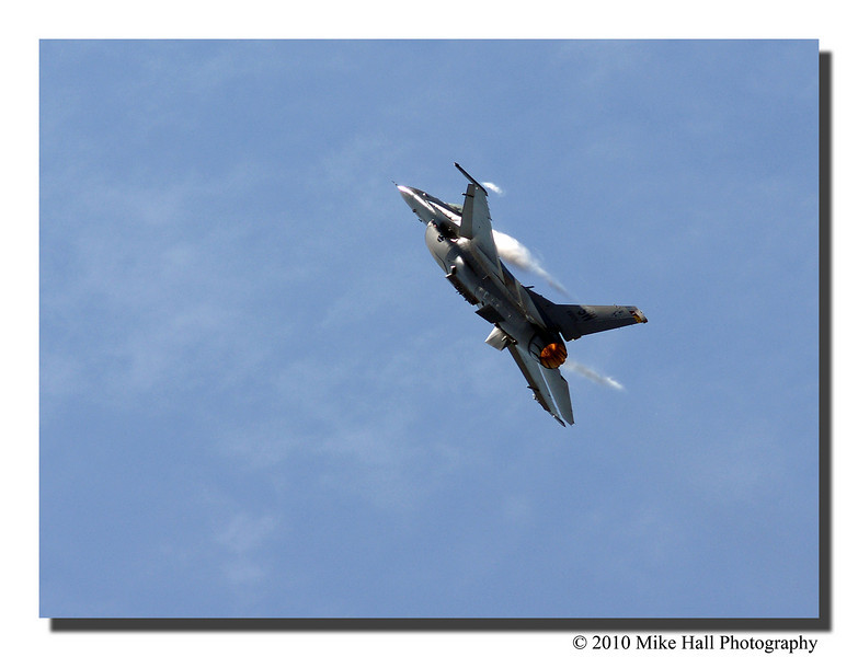 """""""After Burner""""<br /> The F-16 banks after the Mach 1 flyby."""