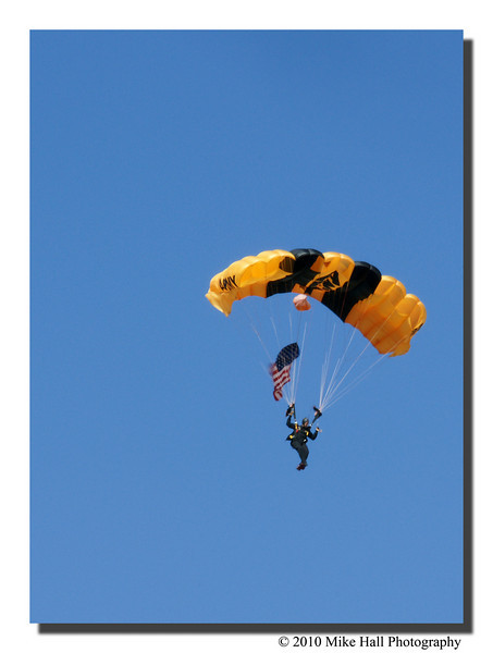 """""""Golden Knights""""<br /> The lead US Army Golden Knight landing with the American flag during the opening ceremony."""