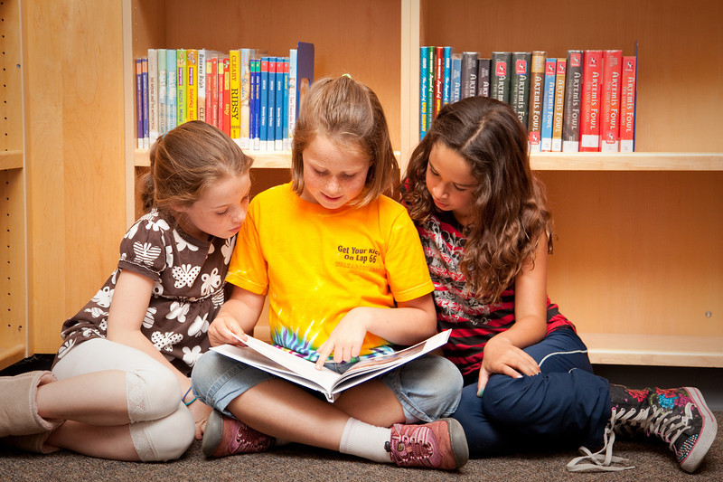 June 15, 2010<br /> Young writer and her audience <br /> My younger daughter is reading her own book to her friends