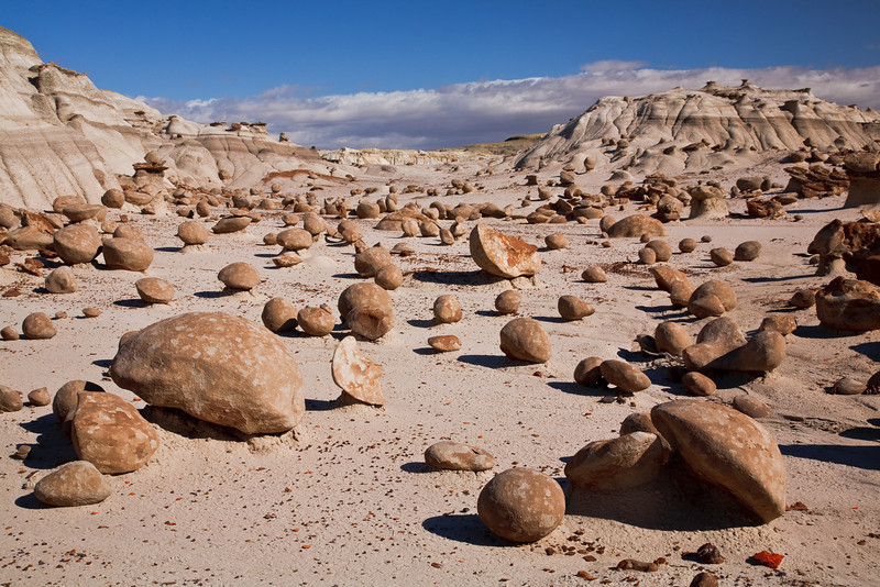 "June 14, 2010<br /> Pumpkin Field in Bisti Badlands (it's not Mars it's New Mexico)<br /> <br /> <br /> <a href=""http://en.wikipedia.org/wiki/Bisti/De-Na-Zin_Wilderness"">http://en.wikipedia.org/wiki/Bisti/De-Na-Zin_Wilderness</a>"