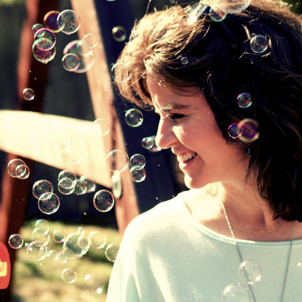 February, 2010<br /> <br /> Darcy happily surrounded by bubbles. :)