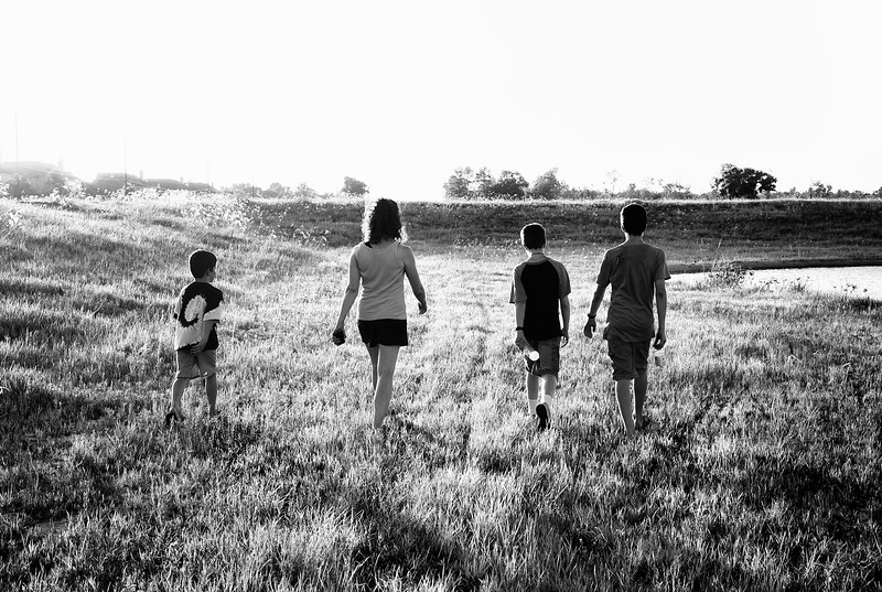 July, 2010<br /> <br /> Darcy and 3 of the boys walk near a pond behind our house.