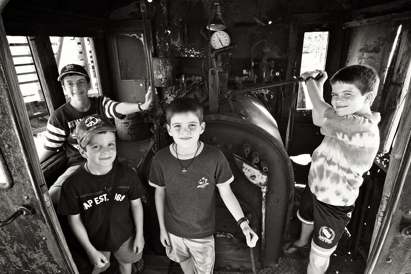 June, 2010<br /> <br /> The boys inside an old train engine.