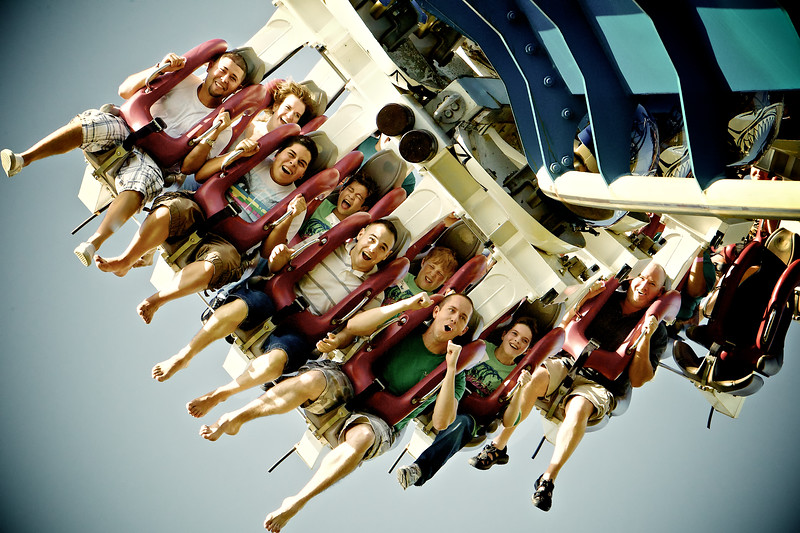 March, 2010<br /> <br /> Riders come around a bend on a coaster at Sea World, San Antonio, TX.<br /> Darcy and Dylan are on the second row.