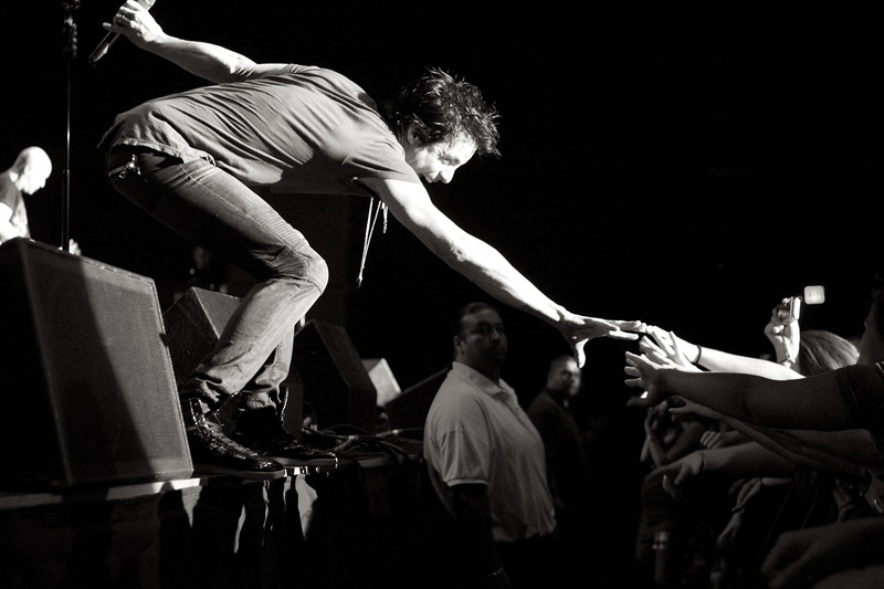 May, 2010<br /> <br /> Train lead singer, Pat Monahan, reaches for the crowd.
