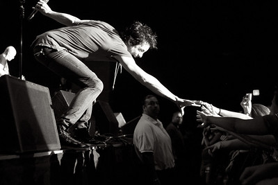 May, 2010  Train lead singer, Pat Monahan, reaches for the crowd.