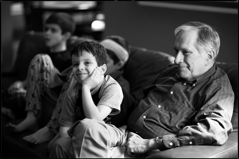 January, 2010<br /> <br /> Ethan happily hanging out with my Dad while we watch a movie.