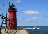 August 20 2010 South Haven Michigan Lighthouse<br /> <br /> This cast iron lighthouse was built in 1903. It stands at the mouth of the Black River.  Yesterday's post was taken about 100 yards East of the this lighthouse.
