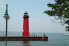 """August 2 2010 Kenosha Wisconsin Lighthouse<br /> <br /> Built in 1906. Owned by the Coast Guard it was deemed """"excess"""" in 2008 and offered at no cost to eligible entities.  Apparently there were no takers."""