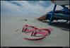 color: wind blown sand on sandals, st simons island, georgia.